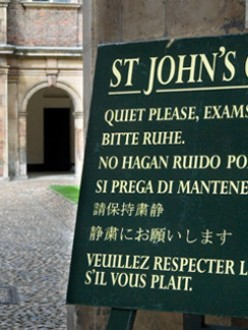 A sign displayed outside a college provides instructions in several languages. (Source: The Economist)