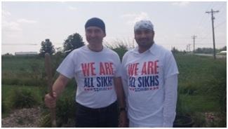 Mark Rensberger (left) and Jagdeep Bola planting roses at the Sikh Gurudwara of Fort Wayne (photo by Lori Way).