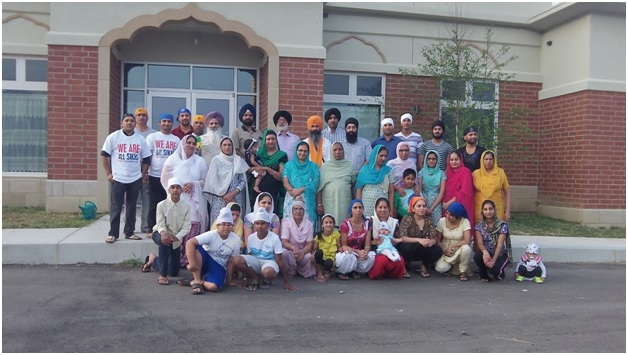 Members of the Dashmesh Sikh Gurudwara at the rose planting ceremony, August 5th, 2014 (photo by Lori Way).