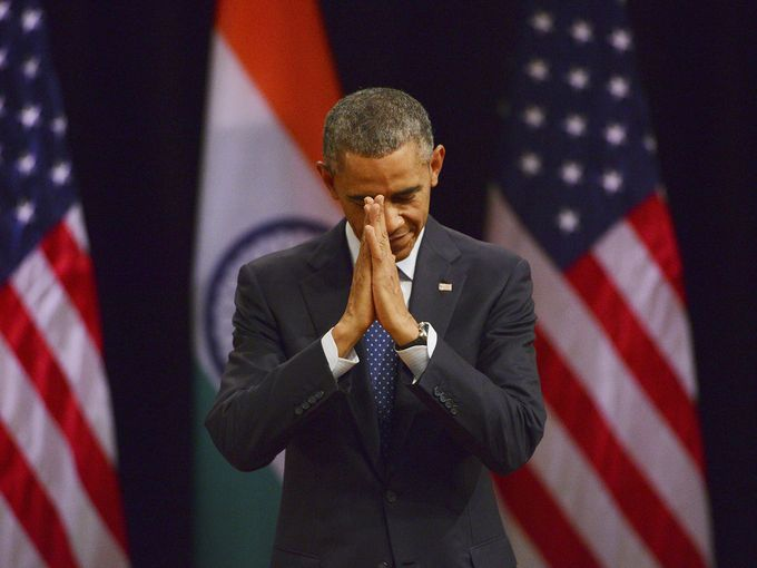"""""""President Obama delivers a traditional Indian greeting before he speaks on Jan. 27 in New Delhi, India. The president, who was guest of honor at India's Republic Day celebrations, wrapped up his visit by talking about the freedom to practice one's religion, the rights of women and the need to provide every child with equal opportunity."""" (Photo: European Pressphoto Agency. Source: USA Today.)."""