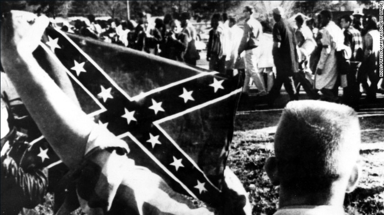 """Dixiecrats resurfaced the  'Southern Cross' flag as a political symbol around the time President Harry Truman supported efforts to end lynchings and desegregate the military in 1948. During that same period, the Ku Klux Klan began using the flag more widely."" (Source: CNN."